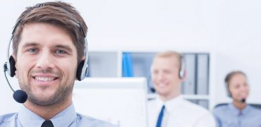 Guy in call center with head set in place