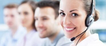 Woman working in call center with head set on