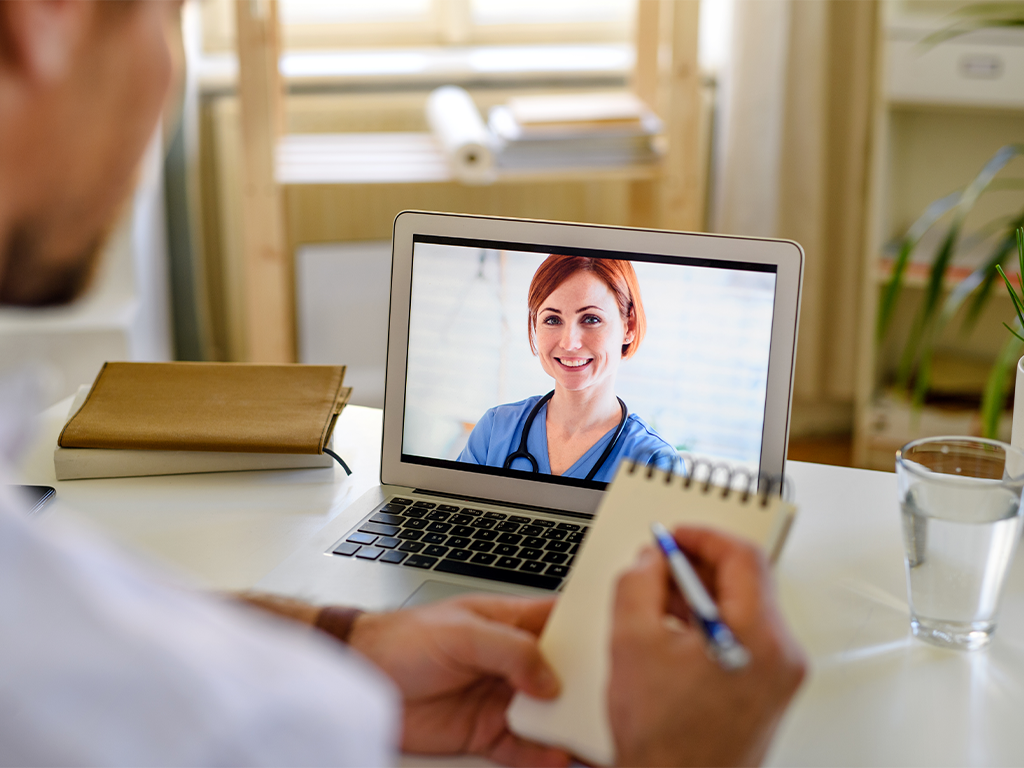 Man receiving Telehealth advice from a doctor via video
