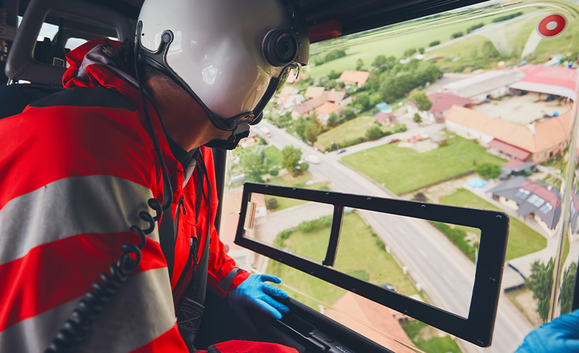 Medical helicopter with first responder looking out the window
